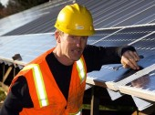 happy solar panel worker